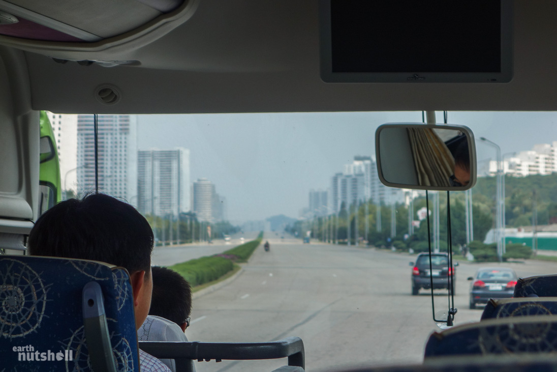 Exiting Pyongyang. Eerily desolate for a capital city. Some Chinese-made vehicles can be seen.