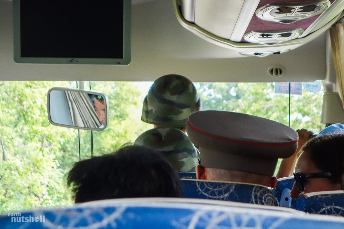 KPA accompanying us on the short drive into the DMZ, between tank traps and active minefield.