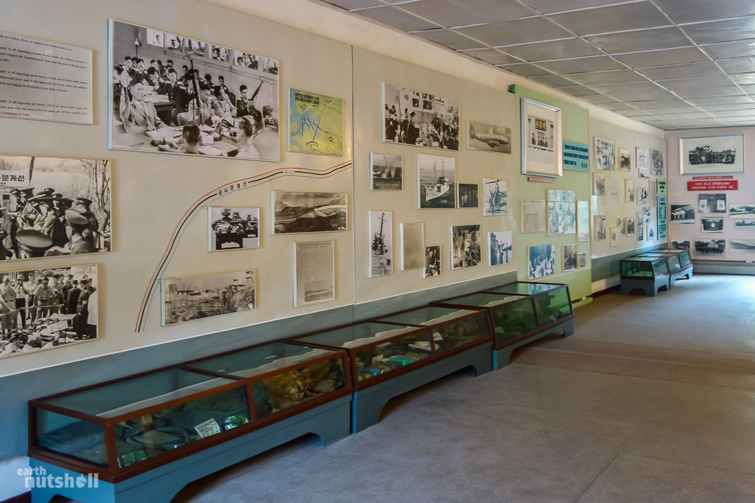Just one wall of propaganda photos within the North Korea Peace Museum at Panmunjom