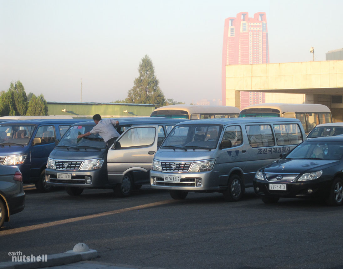 My transport, a Korea International Tourist Company (KITC) van. This is taken in the Yanggakdo Hotel carpark in Pyongyang. These are all cleared out by 9am.