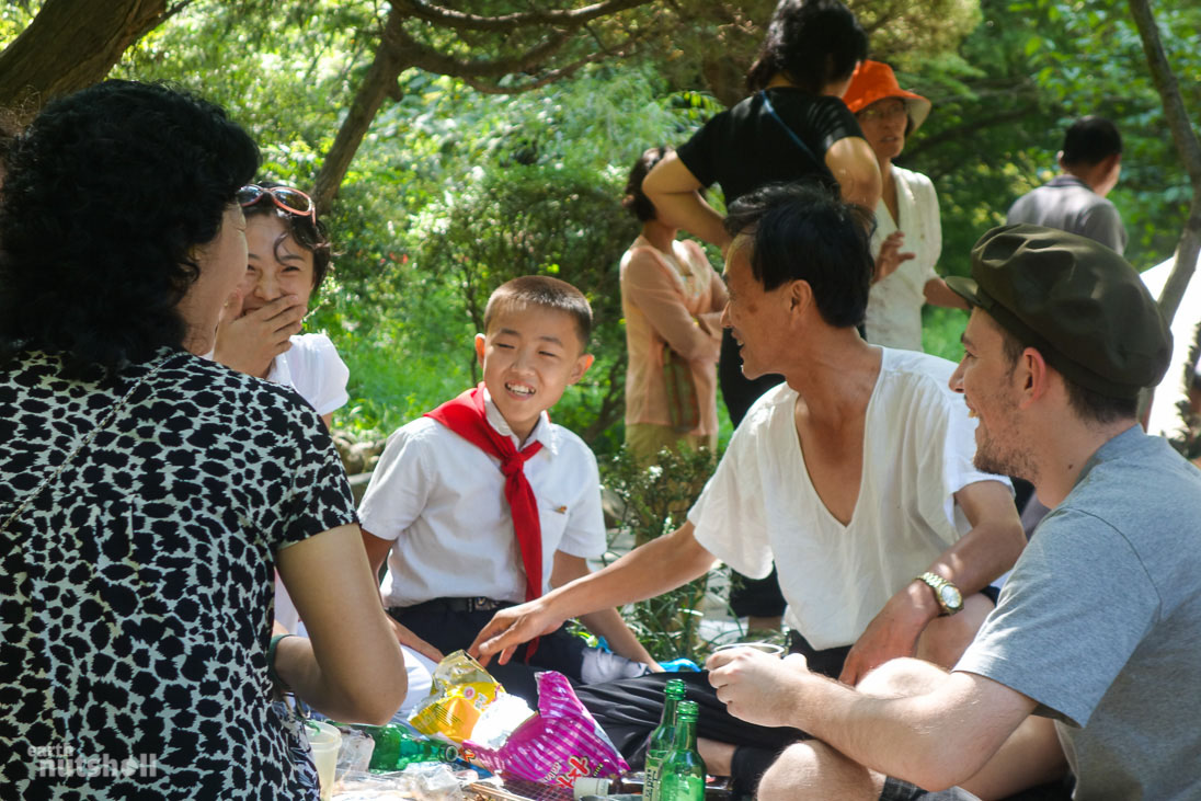"Having lunch and far too much Soju (rice wine) during National Day celebrations with a local Pyongyang family, whom invited me over to join them. One of my guides acted as translator, as I asked them all sorts of heavy questions about what it's like living in Pyongyang. You'll be shocked to learn, ""it's a great place to live, everyone has a job."""