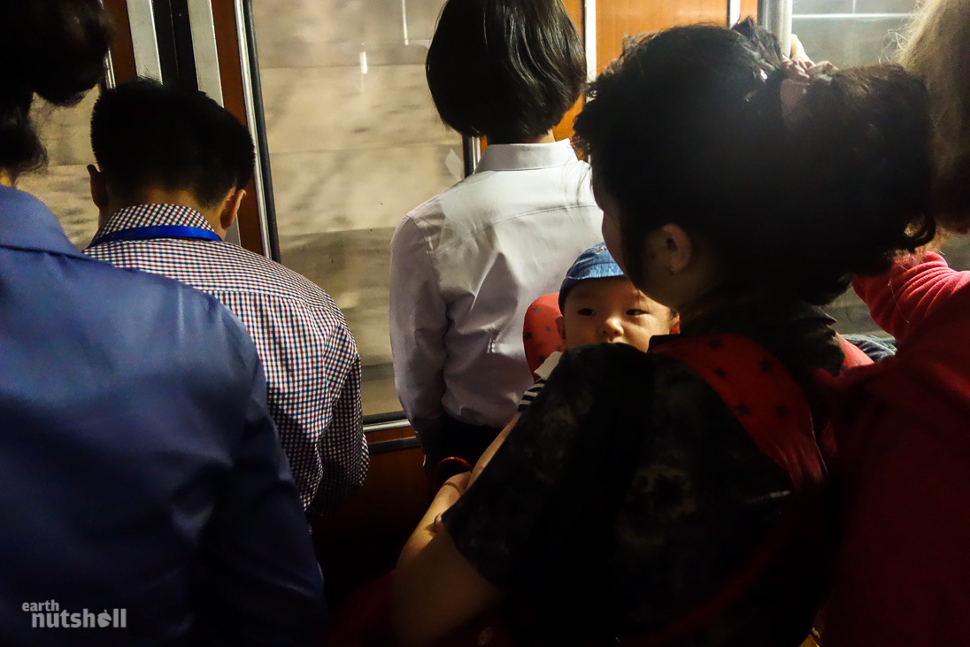 38-pyongyang-metro-commuter-carrying-baby