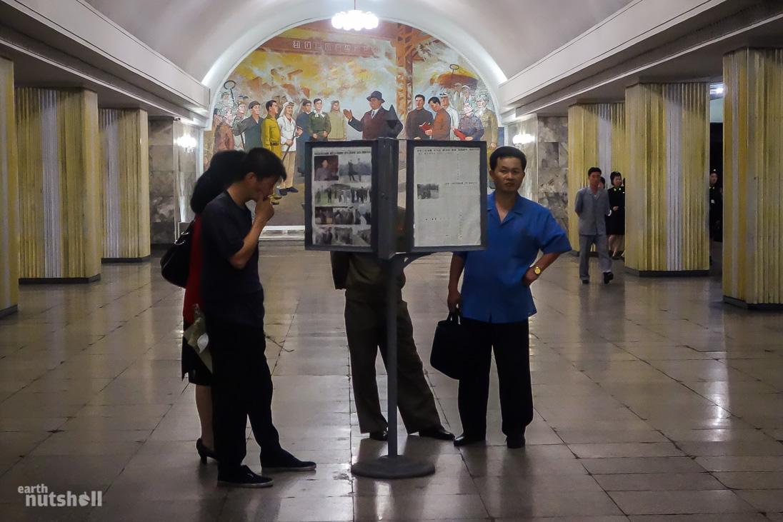 47-pyongyang-metro-commuters-reading-hyoksin