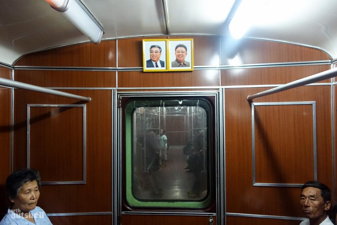 7-pyongyang-metro-inside-train-leaders